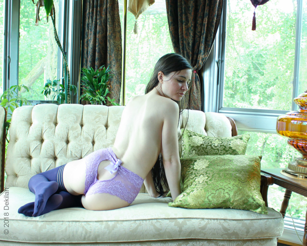 Dekilah wearing a purple Fidditch Designs lingerie set